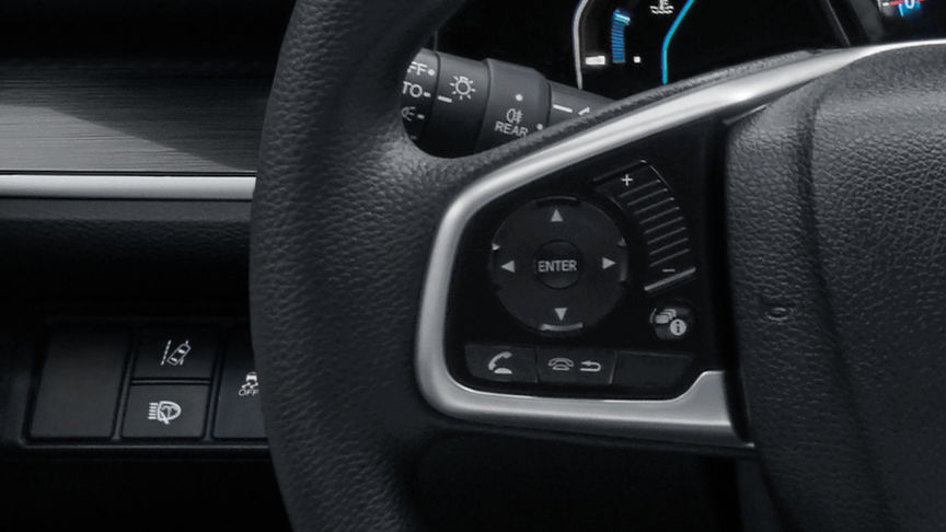 Close up of Driver Information Display dials on steering wheel.